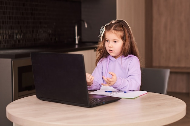 Girl student online learning class with laptop at home