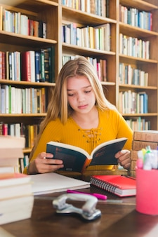 Girl studying in school library