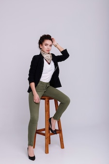 Girl in a stylish fashionable office image.  work searches