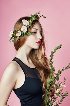 Girl summer look beautiful clothes. flowers wreath