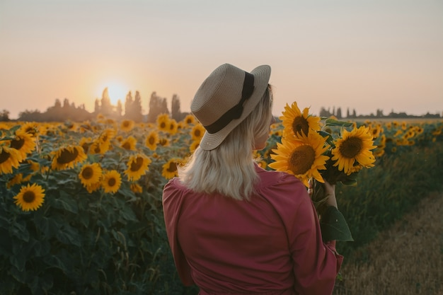 The girl in the sunflowers at sunset.