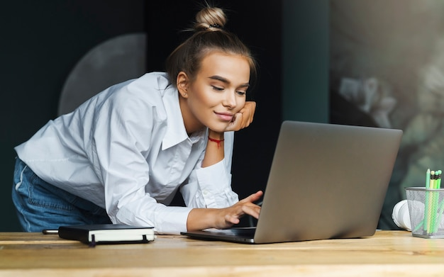 Girl surfing internet for personal and professional purposes.