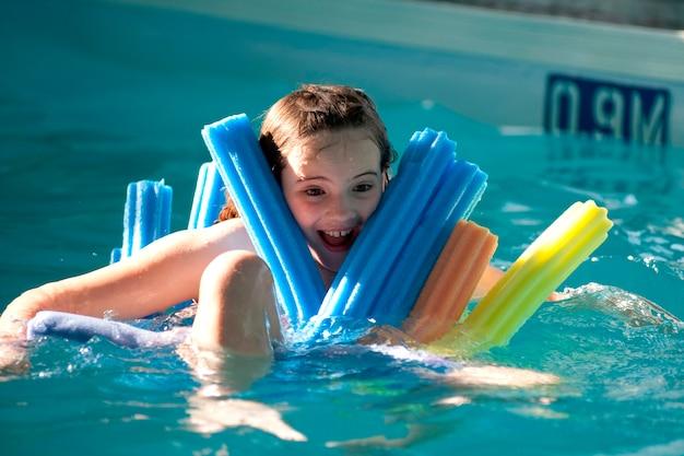 Girl in a swimming pool at gimli, manitoba, canada