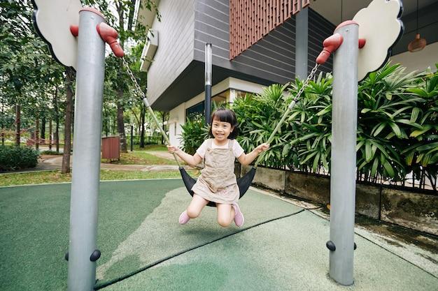 Girl swinging alone