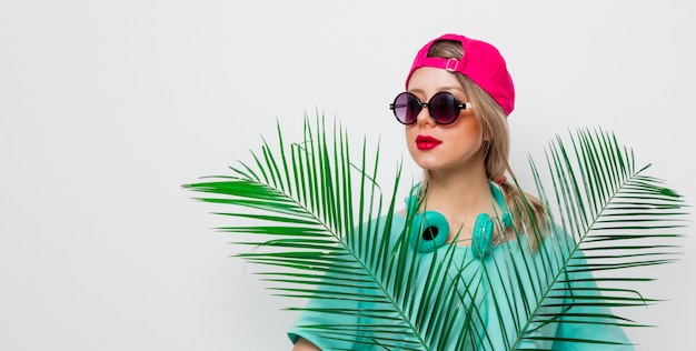 Girl in t-shirt with green palm branch