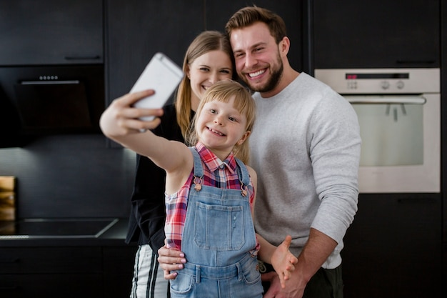 Girl taking picture of family