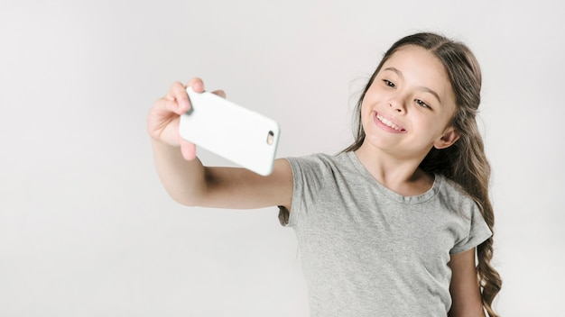 Girl taking selfie in studio