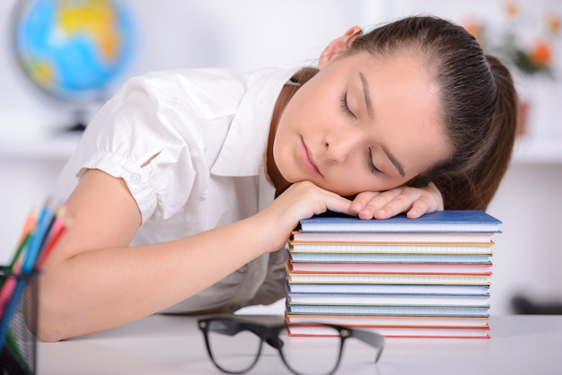 Girl taught lessons in school and sleep on lesson.