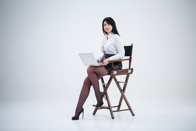 Girl teacher, businessman is studying a new project on a laptop. working day concept
