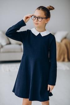 Girl teenager in school uniform