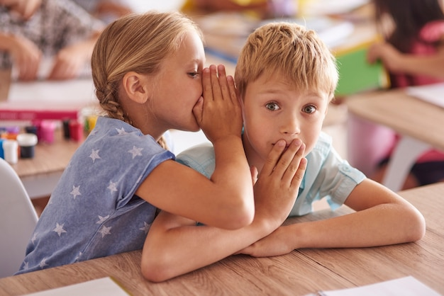 Girl telling friend a big secret