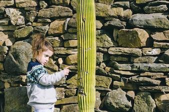 Girl touching cactus