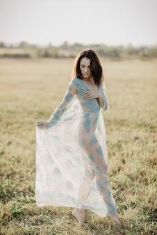 Girl in underwear topless in field in summer outdoor