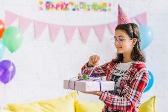Girl unwrapping birthday gift