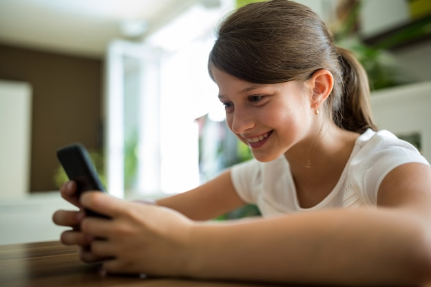 Girl using mobile phone in the living room