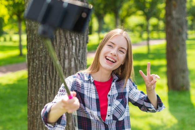 Girl using a selfie stick for a photo