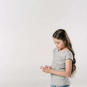 Girl using smartphone in studio