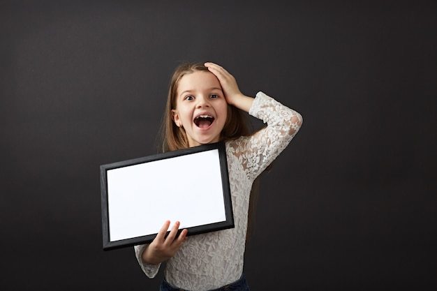 Girl very happy clutching his head and holding a blank form