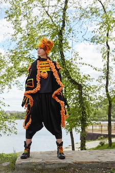 Girl in a vintage ethnic fashion handmade dress posing outdoors