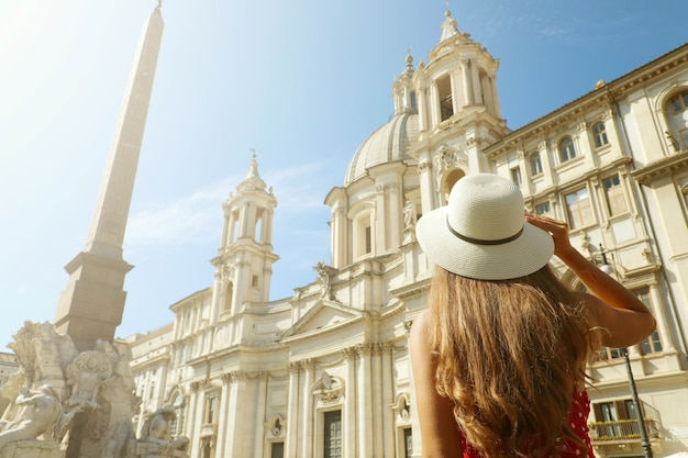 Girl visiting piazza navona square in rome, italy