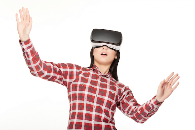 Girl in vr surprised looking up and playing game.