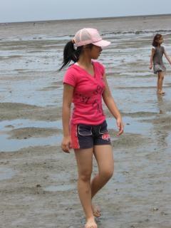 Girl wading through mud
