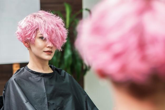 Girl waiting for hairdresser in hairdressing beauty salon