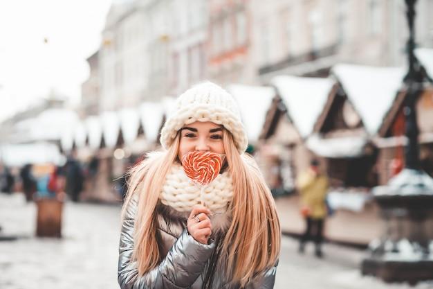 Girl walking at the christmas fair