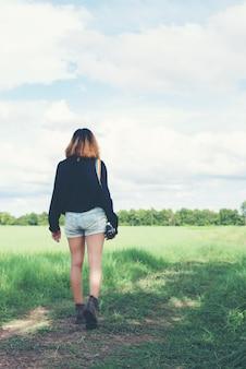 Girl walking in the field