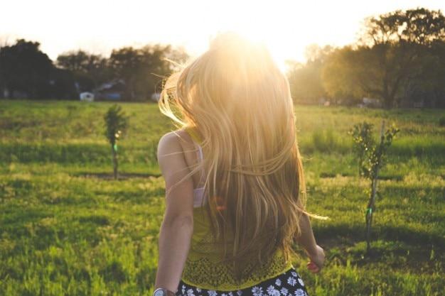 Girl walking through countryside