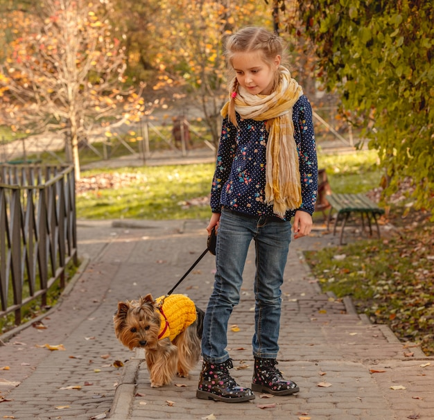 Girl walking with yorkshire terrier