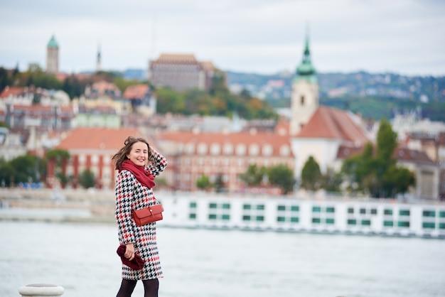 Girl walks along the embankment of budapest