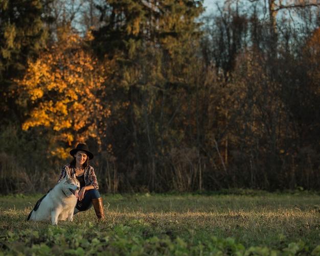 Girl walks with husky