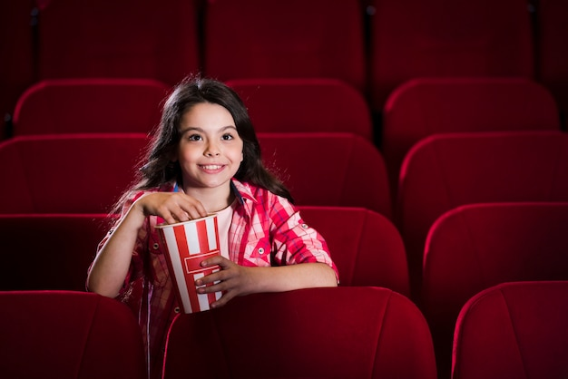 Girl watching movie in cinema