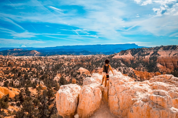 A girl watching the views from the sunrise point in bryce national park. utah, united states