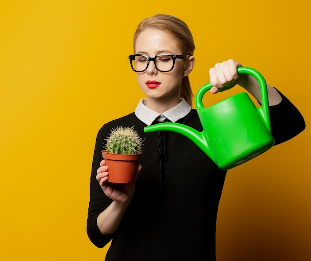 Girl watering a cactus