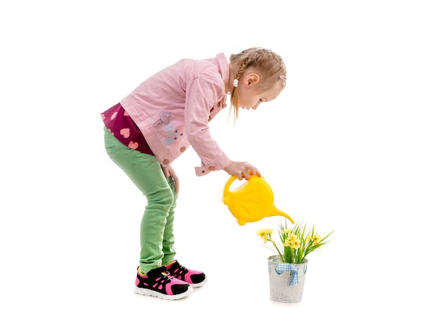 Girl watering flowers, isolated on white background