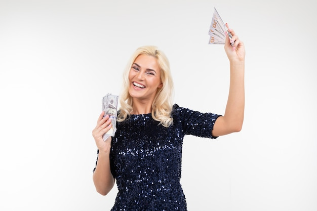 Girl waving hands holding money in them on a white background with copy space. finance