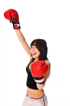 Girl wearing boxing gloves with a rised hand