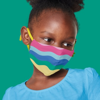 Girl wearing rainbow face mask