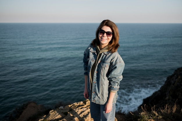 Girl wearing sunglasses and ocean