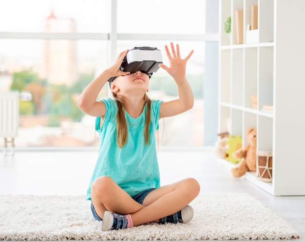 Girl wearing virtual reality glasses