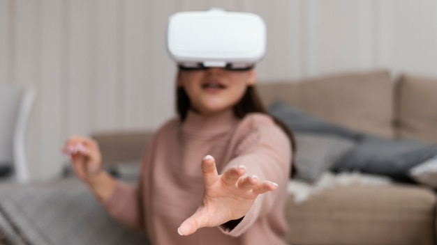 Girl wearing vr glasses medium shot