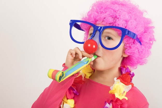 Girl wearing wig and clown glasses and smiling for carnival