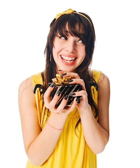Girl wearing yellow dress with a gift box