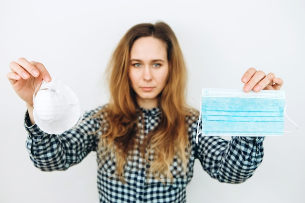 The girl wears a reperitor on a white wall. protective drugs against coronavirus. the covid 2019 epidemic.
