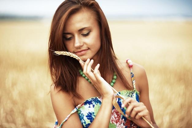 Girl in wheat meadow