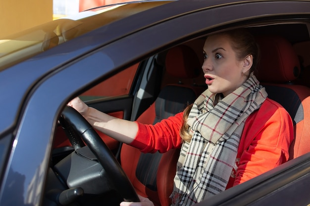 The girl behind the wheel of car in shock