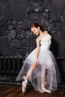 Girl in a white ball gown and shoes