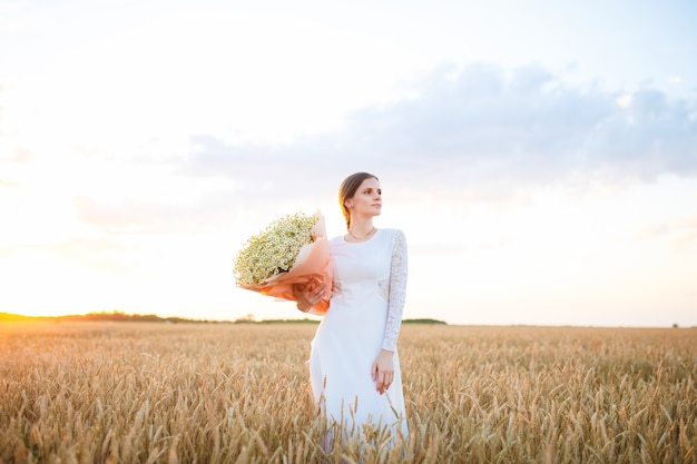 Girl in a white dress at sunset